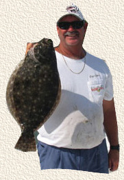 Capt. John holding a large Port Canaveral Flounder, a frequent occurrence aboard the Goin Off.